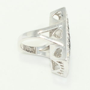 Sideview oversized silver ring with crystals and heart cut out gallery.