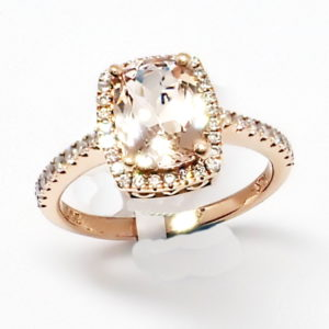 14kt rose gold dainty halo ring with peachy pink Morganite center and diamond accents